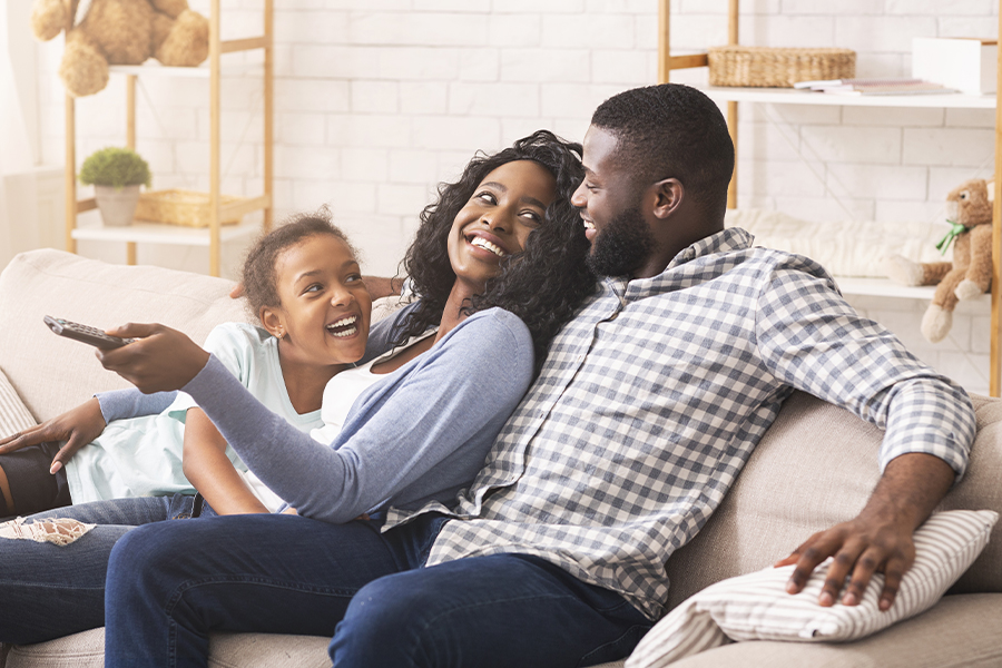 Blog - Joyful Family Having Fun Together and Relaxing on the Sofa at Home