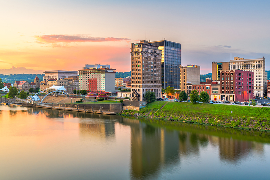Contact - Charleston, West Virginia City Skyline in Front of River at Sunset